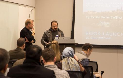 Imam Yahya Hendi and Fr. Greg Schenden give opening remarks